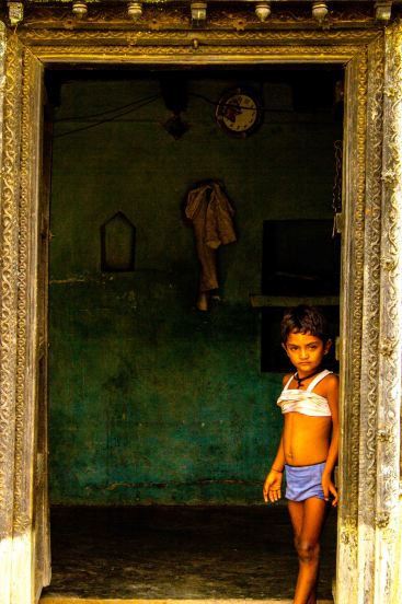 It seems as if time hasn't ticked in this village since ages.  The innocence of the girl has made the  frame intriguing.