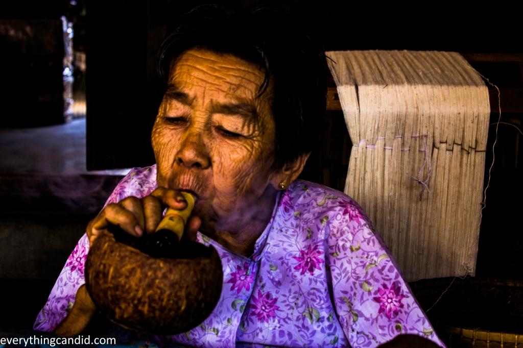 Tribal Woman of Burma smoking Cigar.